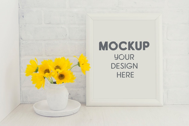 Empty white frame mockup with a bouquet of yellow sunflower flowers in a vintage vase Premium Psd
