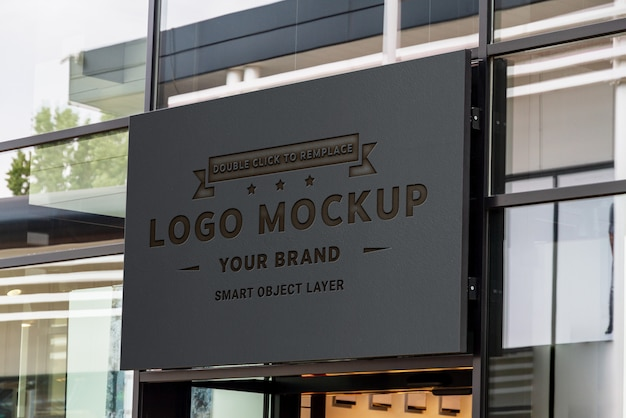Engraved signboard on shop front window mockup Premium Psd