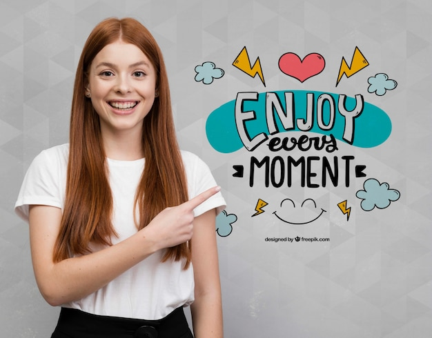Enthusiastic woman pointing at mock-up Free Psd