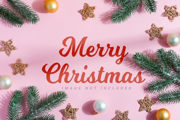Evergreen fir twigs, stars, small golden and silver spheres. merry christmas greeting card Premium Psd