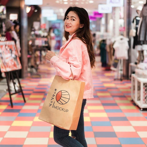 Female walking in the mall with shopping bag Free Psd