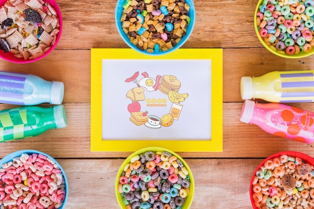 Flat lay of arrangement of cereals and milk bottles Free Psd