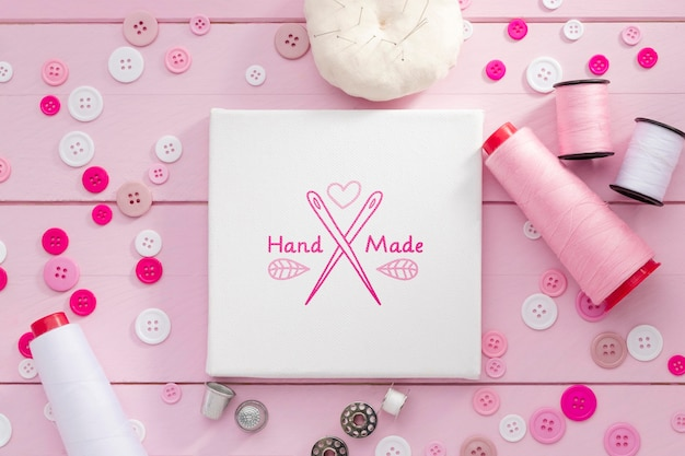 Flat lay arrangement with pink thread Free Psd