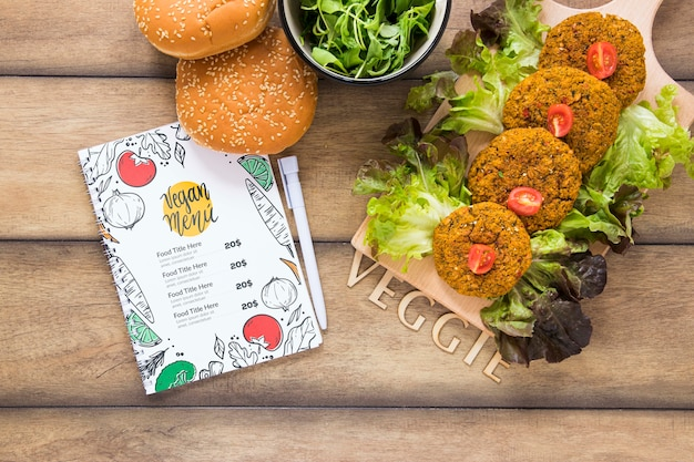 Flat lay arrangement with tasty food on wooden table Free Psd