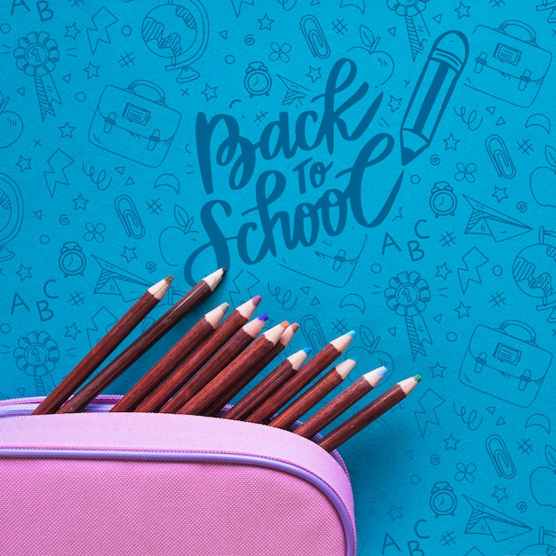 Flat lay back to school event with pencils in a box Free Psd