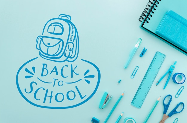 Flat lay back to school with blue supplies Free Psd