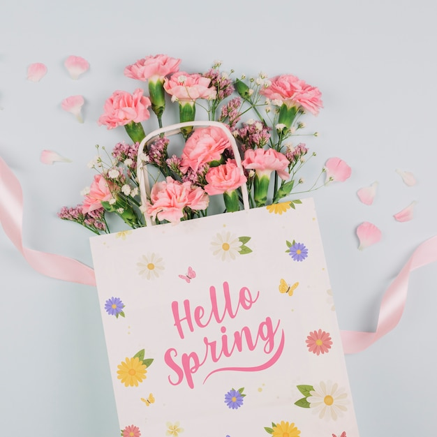 Flat lay bag mockup with spring concept Free Psd