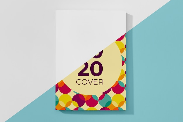 Mock-up libro piatto laici con cerchi colorati Psd Gratuite