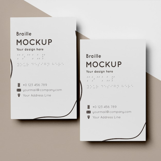 Flat lay of business card design with braille writing Free Psd