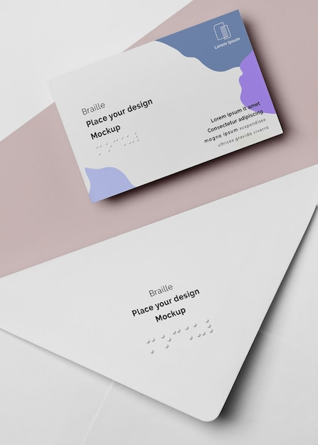 Flat lay of business card with braille in envelope Free Psd