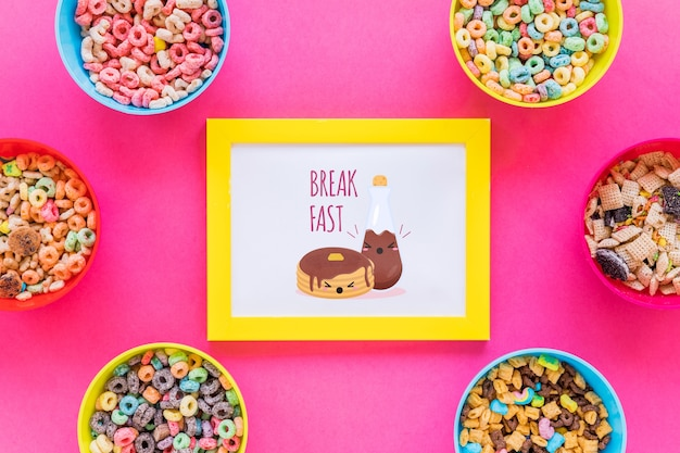Flat lay of cereal bowls and frame with pink background Free Psd