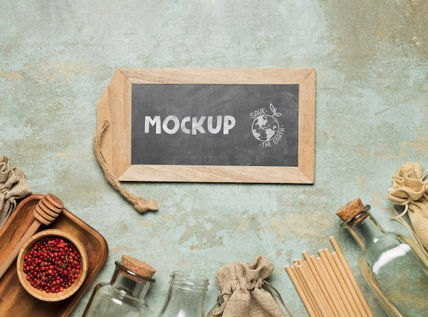 Flat lay of chalkboard and zero waste wooden items Free Psd