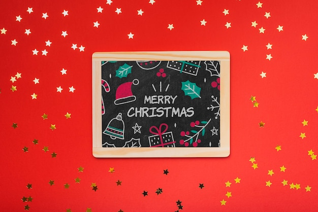 Flat lay of christmas concept chalkboard with red background Free Psd