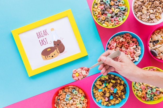 Flat lay of colorful cereals bowls and frame Free Psd