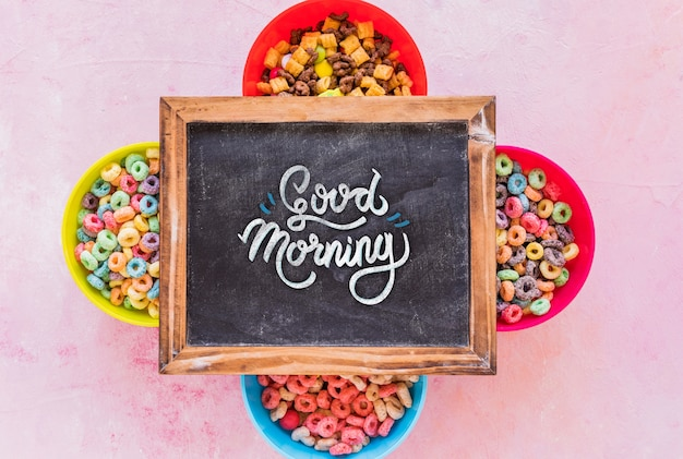 Flat lay of colorful cereals and chalkboard on plain background Free Psd