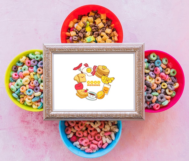 Flat lay of colorful cereals and frame on plain background Free Psd