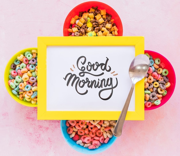 Flat lay of colorful cereals spoon and frame on plain background Free Psd