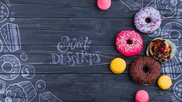 Flat lay composition of donuts Free Psd