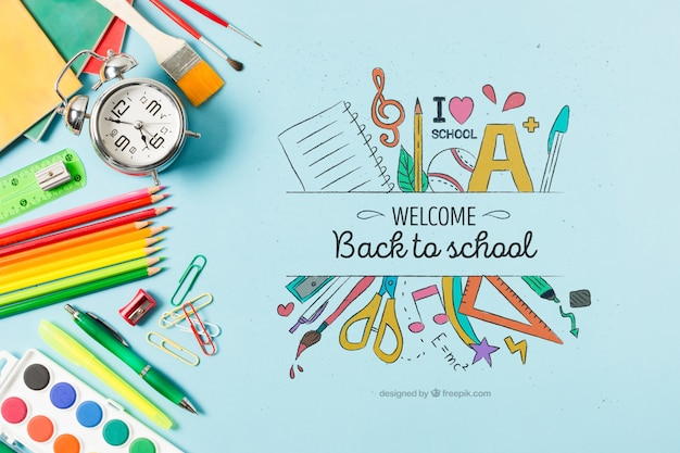 Flat lay decoration with school supplies on blue background Free Psd