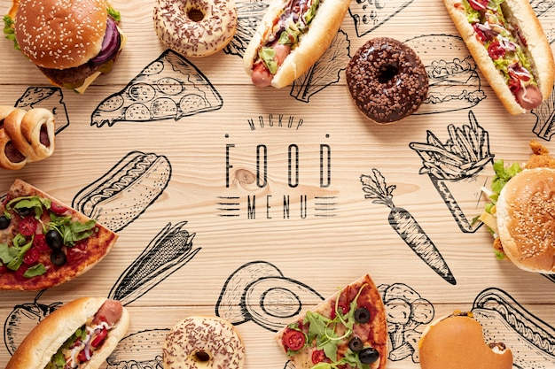 Flat lay of delicious fast food on wooden table Free Psd