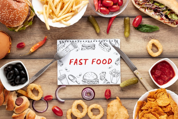 Flat lay of delicious fast foon on wooden table Free Psd