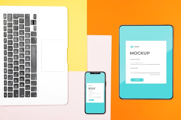 Flat lay digital tablet and mobile phone mock-up Free Psd