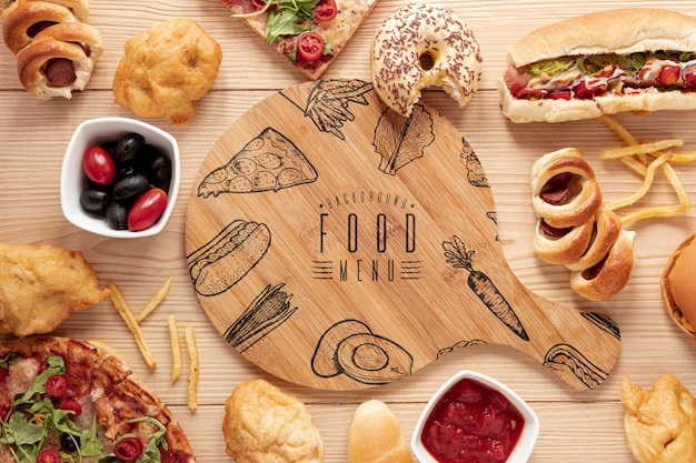 Flat lay of fast food on wooden table  mock-up Free Psd