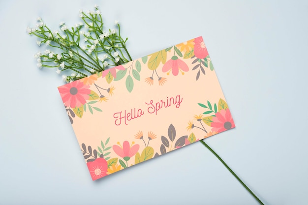 Flat lay of floral card for spring Free Psd