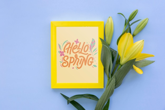Flat lay frame mockup with spring flowers Free Psd