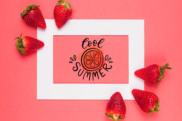 Flat lay frame mockup with strawberries Free Psd