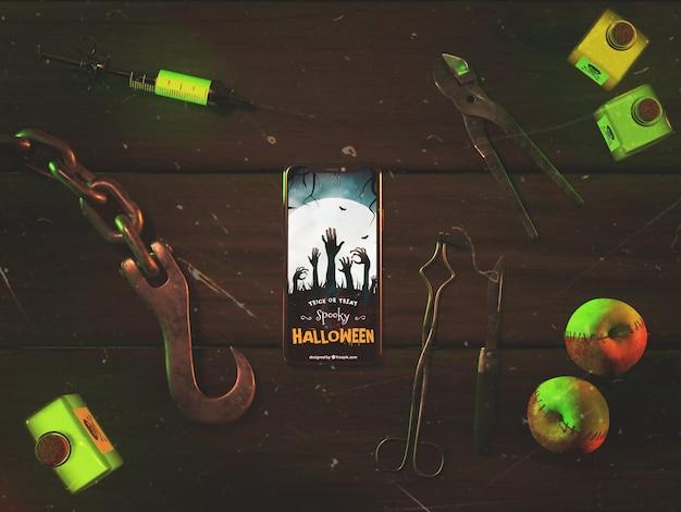 Flat lay halloween arrangement with phone Free Psd