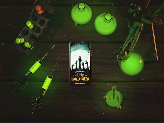 Flat lay halloween concept with smartphone Free Psd