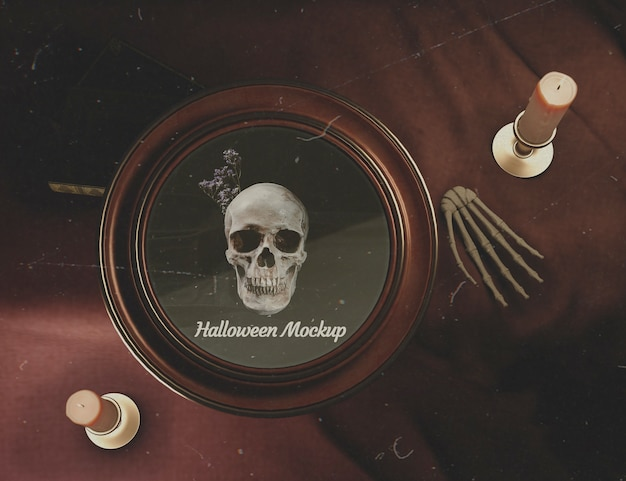 Flat lay halloween round frame with skull on a desk Free Psd