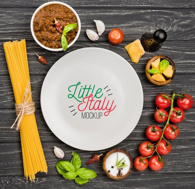 Flat lay italian food and plate assortment Free Psd
