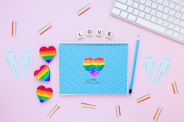 Flat lay lgbt pride composition with notepad template Free Psd