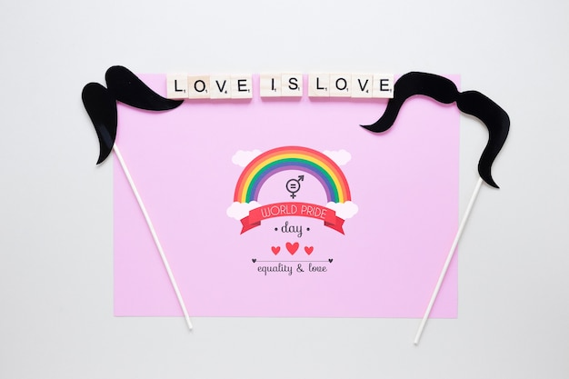 Flat lay lgbt pride composition with paper template Free Psd