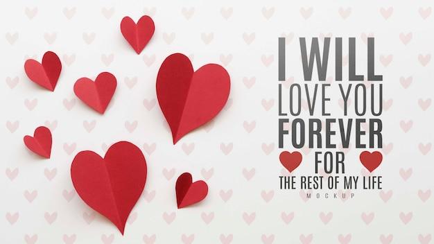 Laico piatto del messaggio d'amore con cuori di carta Psd Gratuite
