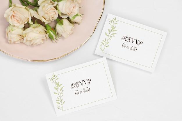 Flat lay mockup invitation card and number card Premium Psd