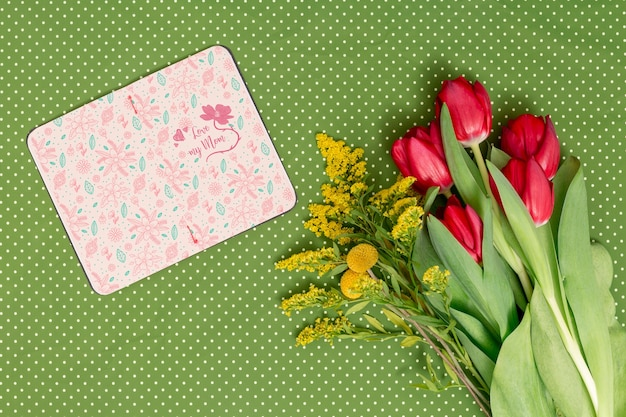 Flat lay mothers day composition with open book mockup Free Psd