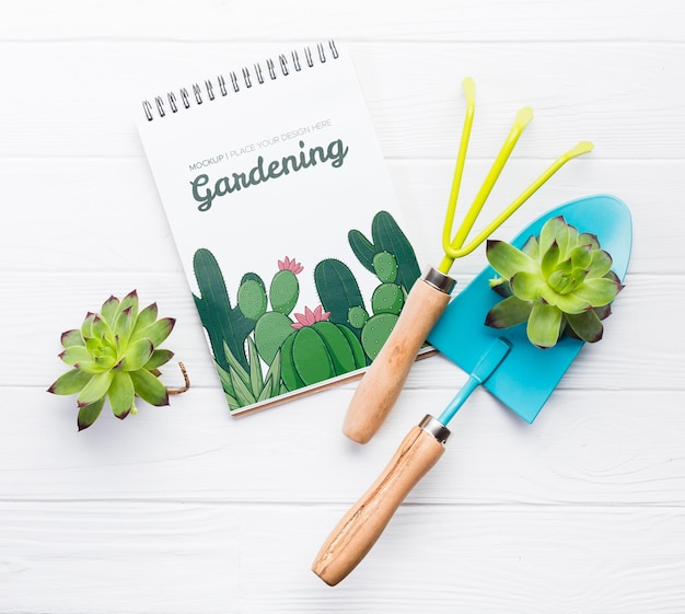 Flat lay notebook and blue shovel Free Psd
