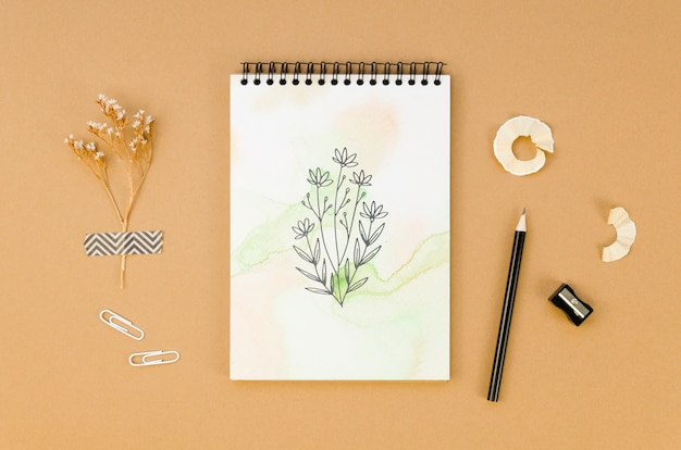 Flat lay notepad mock-up on brown background Free Psd