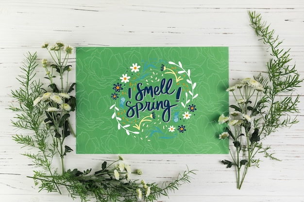Flat lay paper card mockup with spring concept Free Psd