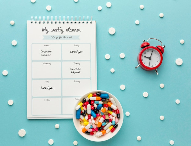 Flat lay pills and notebook arrangement Free Psd