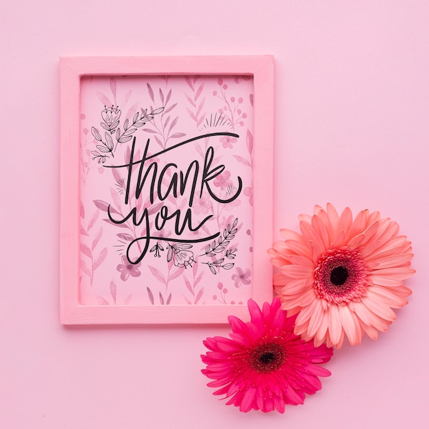 Flat lay of pink frame on pink background Free Psd