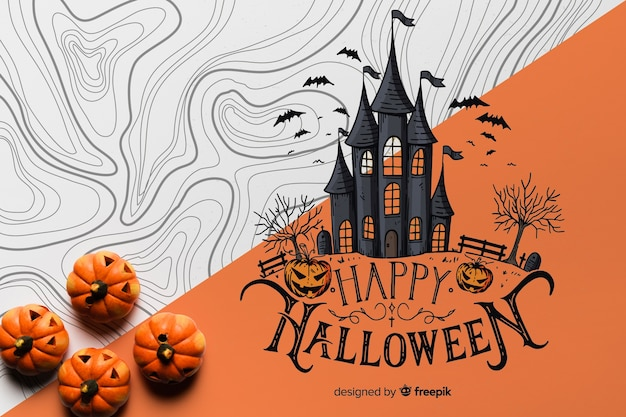 Flat lay of pumpkins with haunted house Free Psd
