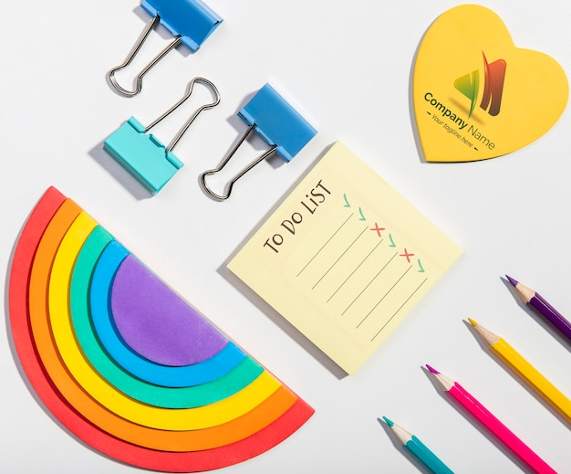 Flat lay rainbows and pencils knolling desk concept Free Psd