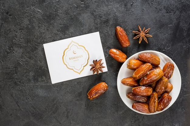 Flat lay ramadan composition with card mockup Free Psd