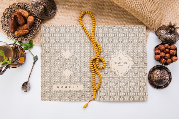 Flat lay ramadan composition with open book template Free Psd