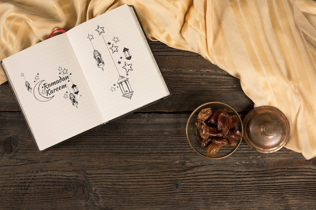 Flat lay ramadan composition with open book Free Psd