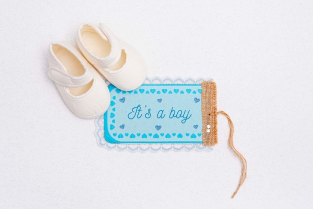 Flat lay of shoes with baby shower decoration Free Psd
